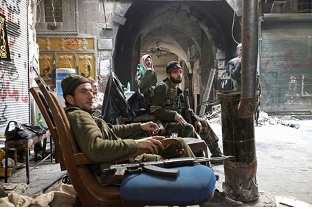 Free Syrian Army fighters rest in the old cit