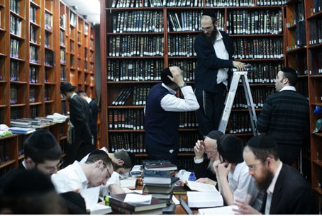Hareidi men study Torah in the Mir yeshiva