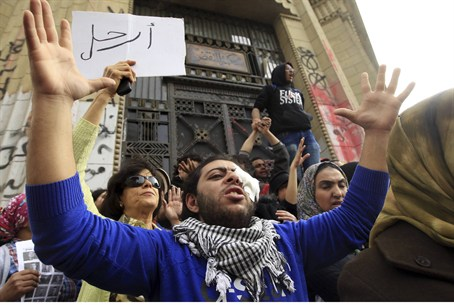 Protesters opposing Morsi during a protest ne