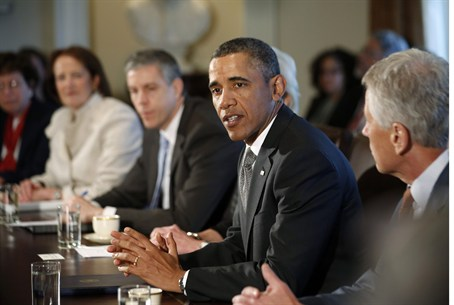 Obama participates in his first cabinet meeti