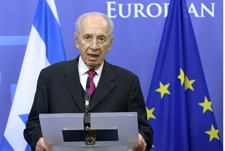President Shimon Peres talks during a news co
