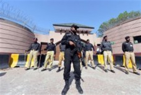 Pakistani police stand guard outside the resi