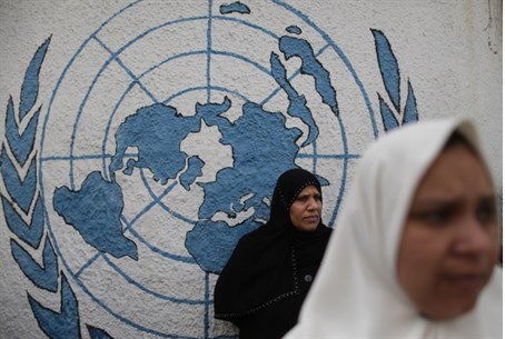 Arab women in front of UN sign