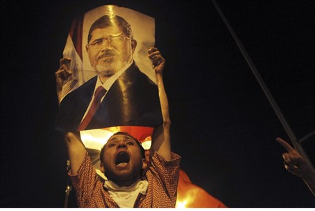 Muslim Brotherhood protestor holds picture of