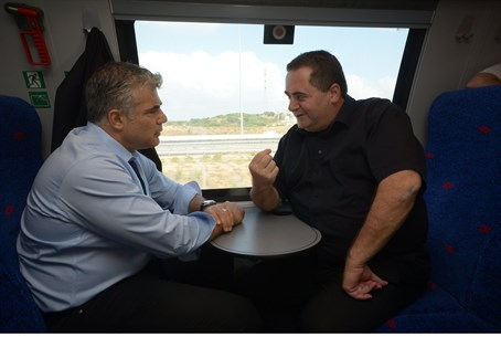 Lapid, Katz ride new TA-Ashdod train