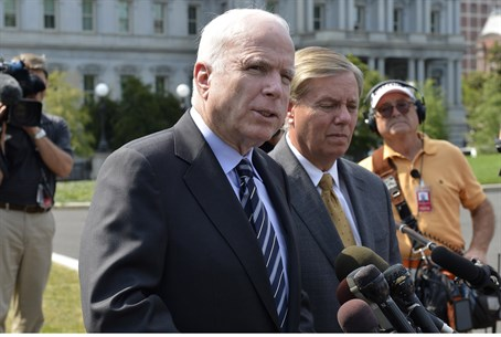 McCain talks to the media after meeting Obama