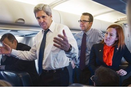John Kerry, Jen Psaki at right (file)