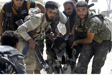 Syrian rebels carry wounded fighter in Aleppo