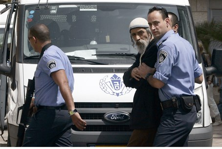 Ofer Gamliel being led to a 2009 court hearin