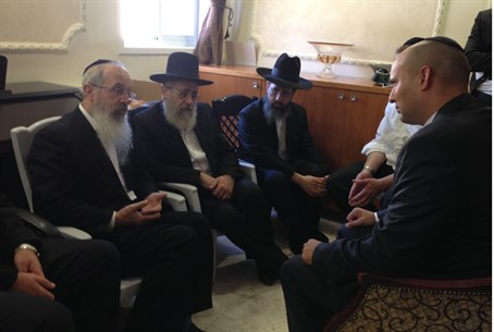 Bennett sits with Rabbi Yosef's sons