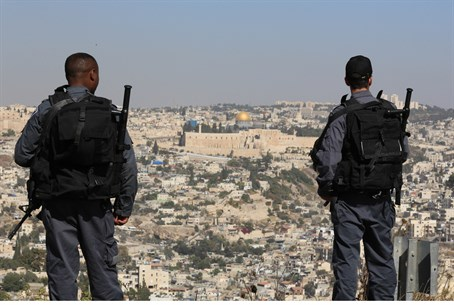 Illustration: Israeli border police stand ove