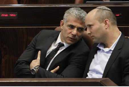 Lapid and Bennett talk during Knesset session