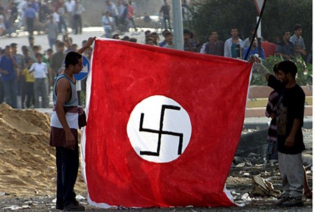 Palestinian Arabs hold Nazi flag (file)