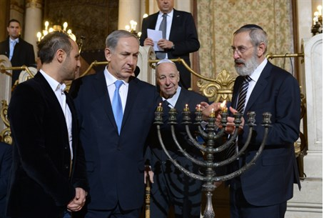 Netanyahu lights Hanukkah candles in Rome