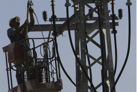 IEC workers fixing electrical outages