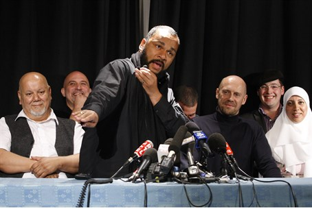 "Dieudonne performs the ""quenelle"" gesture at"