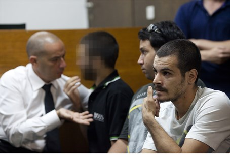 עState witness (center) in court