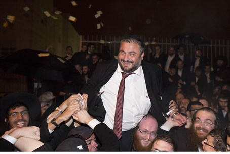 Incumbent Mayor Moshe Abutbul celebrates with