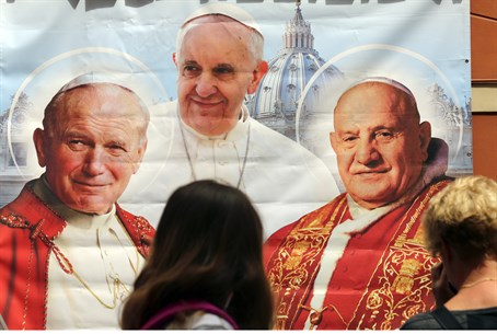 Poster depicting Pope John Paul II (L), Pope