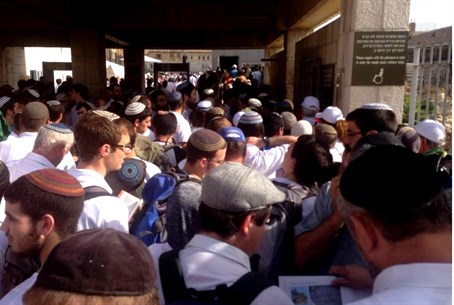 Jews waiting at entrance to Kotel Plaza.