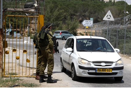 Israeli soldiers stand guard at the entrance