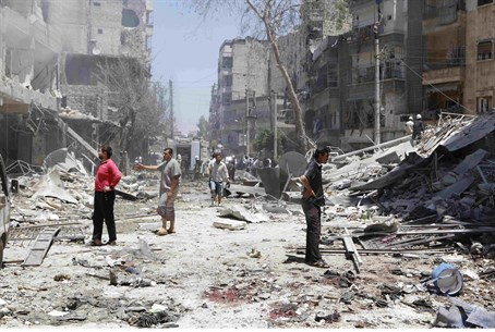 Damage from barrel bomb in Aleppo's district