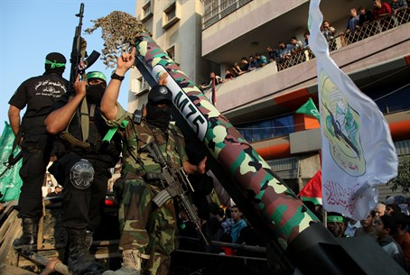Hamas terrorists parade rocket (file)