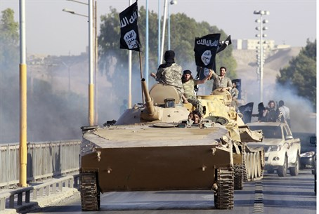 ISIS fighters parade in Raqqa, Syria (file)