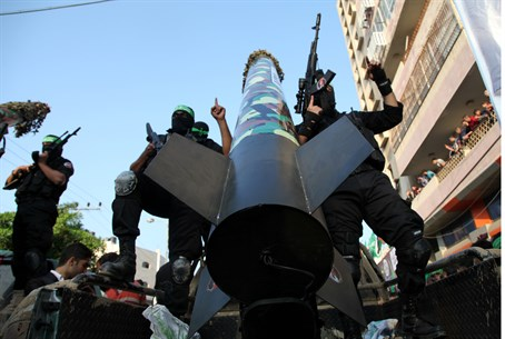 Hamas terrorists parade rocket