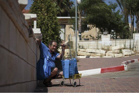 Elderly Sderot man takes cover after siren