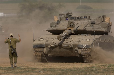 Troops amassing at the border with Gaza