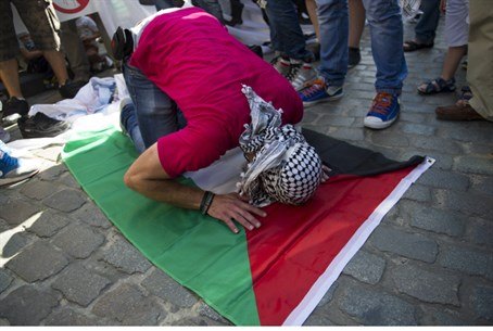 Pro-Palestinian protestor praying to Allah. F