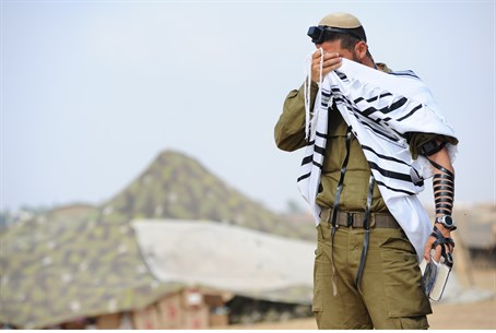 IDF soldier prays near the front line, close