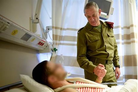 IDF head Benny Gantz meets injured soldier at