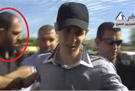 Attar (circled) seen with kidnapped IDF soldi