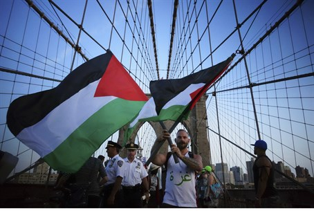 Anti-Israel protesters wave Palestinian flags