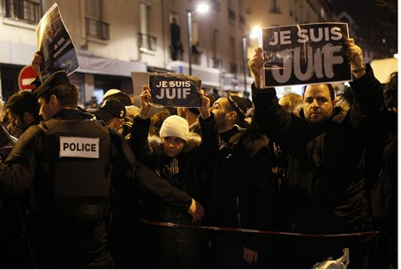 "Protesters hold signs reading ""I am Jewish"" in Paris, after deadly anti-Semitic attack"