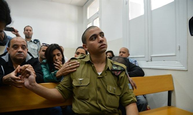 Elor Azariya in court with his parents