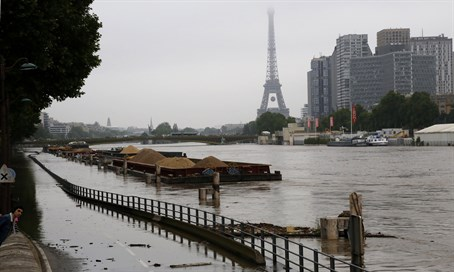 River Seine floods in Paris with Eiffel Tower in background
