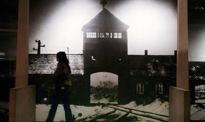 Visitor walks past display at US Holocaust Memorial Museum