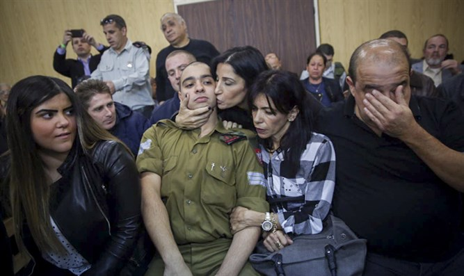 Elor Azariya sits with his family as verdict handed down