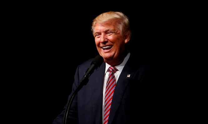 Donald Trump shares a laugh on the campaign trail