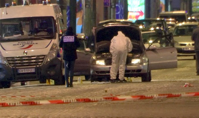 Police inspect car used by Champs Elysees shooter