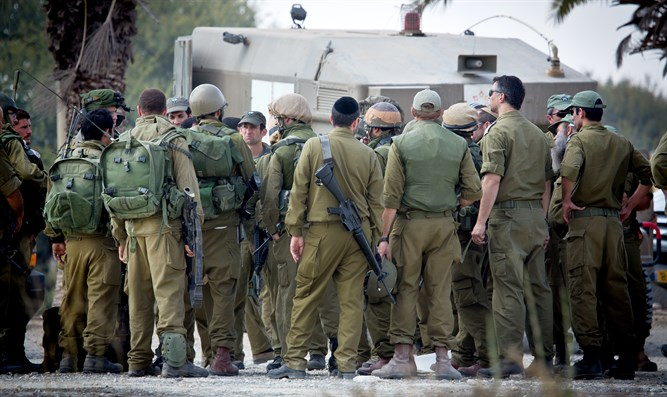IDF reserve soldiers gathering in staging area near Gaza border