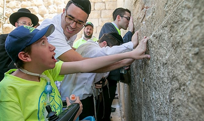 Celebrating the boys' bar mitzvah at the Western Wall