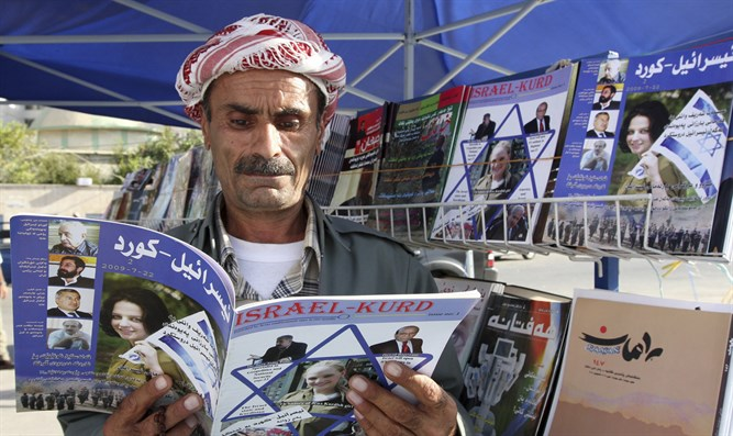 "Man reads copy of magazine ""Israel-Kurd"" at street in Arbil"