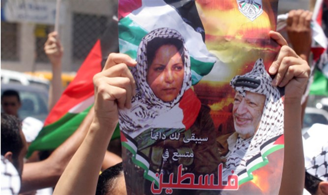 Poster of Dalal Mughrabi in Ramallah demonstration