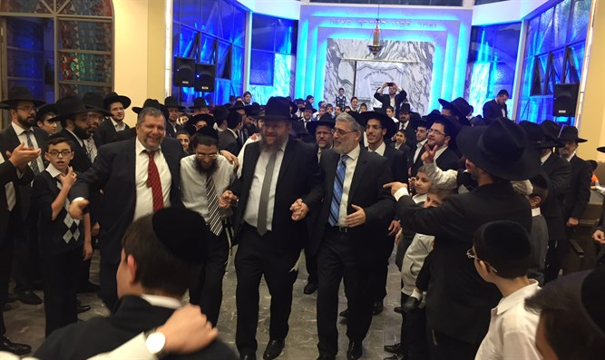 Rabbi Masri dances with community leaders at this week;s Simchat Beit Hashoava celebration